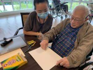 Art Therapist Drawing with Senior
