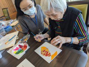 Art Therapist Painting with Senior