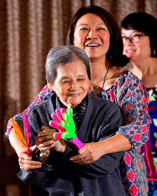 Elena and Francisca Ling dancing together at Villa Cathay Care Home.